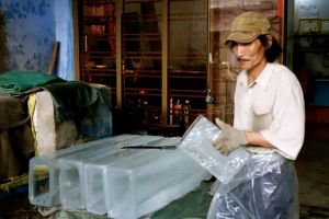worker in family ice factory in Nam O in Vietnam