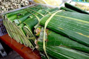 packs of banana leaves cut on rectangular shape sold on the market in Bali island, Indonesia