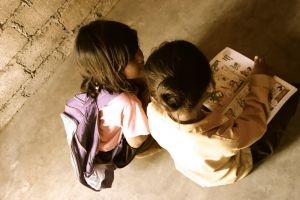 kids reading at school in Lombok village, Indonesia