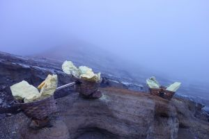80kg baskets with sulfur mined in Ijen volcano, Java, Indonesia