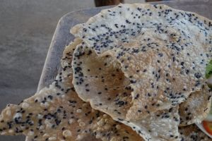 sesame cracker - roasted rice paper, torn and ready as a side dish for lunch