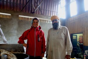 Bo on the road with chapatti baker in Golden temple, Amritsar, India