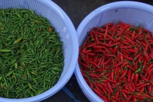 red and green chilies in local market in Vietnam
