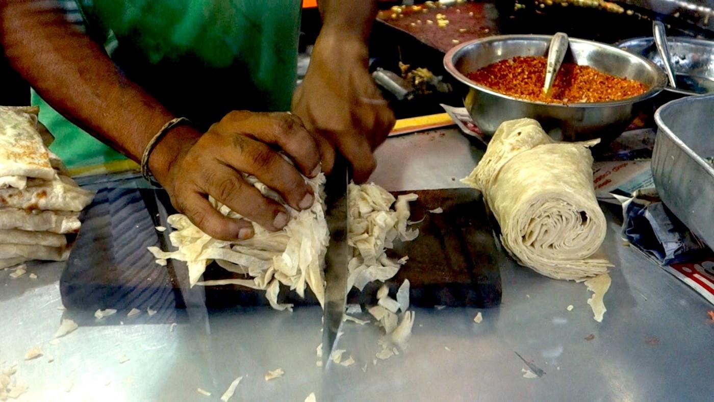 Kottu roti sri lanka exotic recipes authentic world food noodle cutting for kottu roti in sri lanka by authentic world food forumfinder Image collections