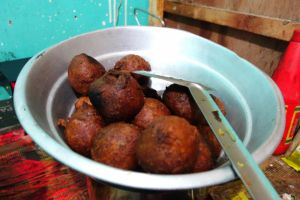 Bonda after removing from wok - banana balls with cardamon in a street restaurant in Kerala, India - by Authentic World Food