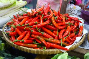 Chilies sold at traditional market on Borneo, Malaysia - by Authentic World Food