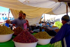 Olive vendor on traditional Moroccan market, souk - by Authentic World Food