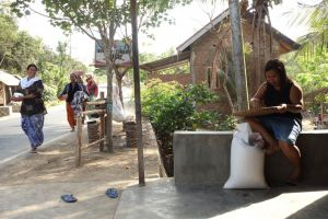 Outdoor food preparations in a street restaurant in Lombok, Indonesia - by Authentic World Food