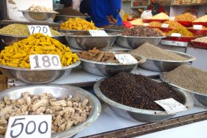 Spices, turmeric included, sold on traditional market in Delhi, India - by Authentic World Food